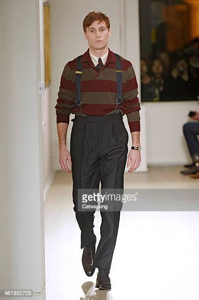 A model walks the runway at the dunhill Autumn Winter 2015 fashion show during London Menswear Fashion Week on January 11 2015 in London United...
