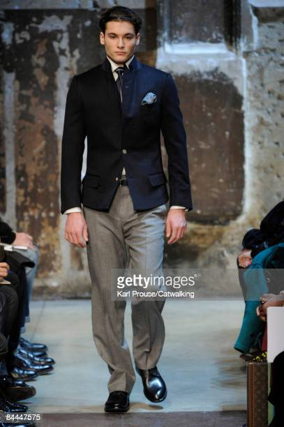 A model walks the runway at the Dunhill fashion show during Paris Fashion Week Menswear Autumn/Winter 2009 on January 25 2009 in Paris France