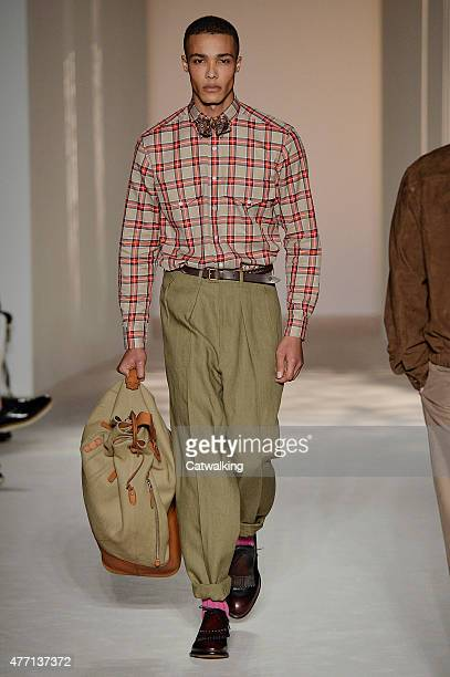 A model walks the runway at the Dunhill Spring Summer 2016 fashion show during London Menswear Fashion Week on June 14 2015 in London United Kingdom