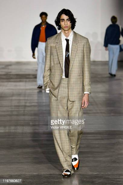 Model walks the runway at the E. Tautz Fall/Winter 2020-2021 fashion show during London Fashion Week Men's January 2020 on January 04, 2020 in...
