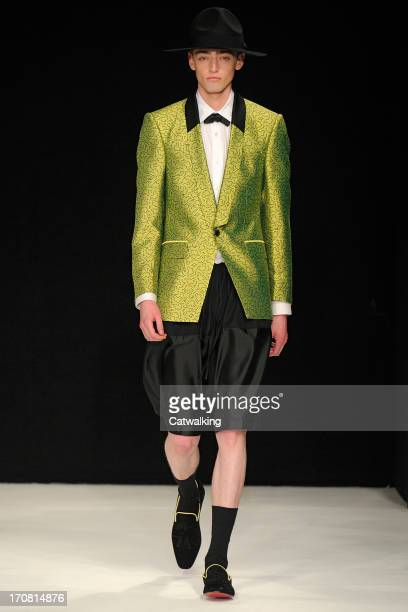 Model walks the runway at the E Tautz Spring Summer 2014 fashion show during London Menswear Fashion Week on June 18, 2013 in London, United Kingdom.