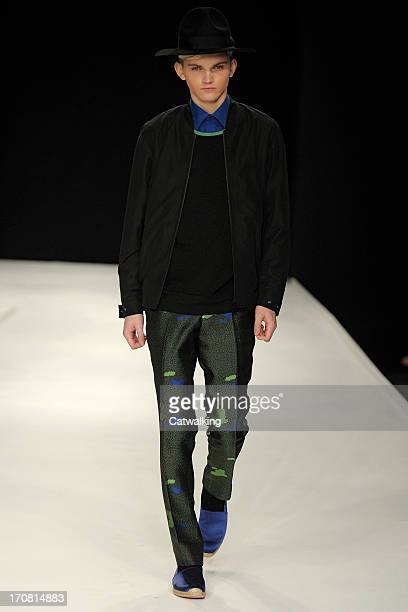 A model walks the runway at the E Tautz Spring Summer 2014 fashion show during London Menswear Fashion Week on June 18 2013 in London United Kingdom