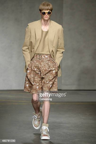A model walks the runway at the E Tautz Spring Summer 2015 fashion show during London Menswear Fashion Week on June 17 2014 in London United Kingdom