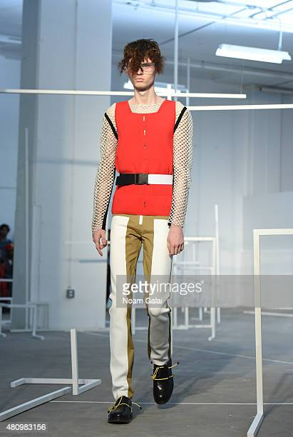 Model walks the runway at the Edmund Ooi fashion show during New York Fashion Week: Men's S/S 2016 on July 16, 2015 in New York City.
