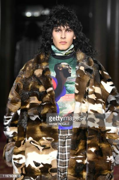 Model walks the runway at the Edward Crutchley Fall/Winter 2020-2021 fashion show during London Fashion Week Men's January 2020 on January 04, 2020...