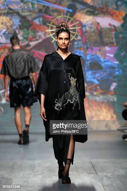Model walks the runway at the Edward Crutchley show during London Fashion Week Men's June 2018 at BFC Show Space on June 9, 2018 in London, England.