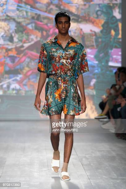 A model walks the runway at the Edward Crutchley show during London Fashion Week Men's June 2018 at BFC Show Space on June 9 2018 in London England