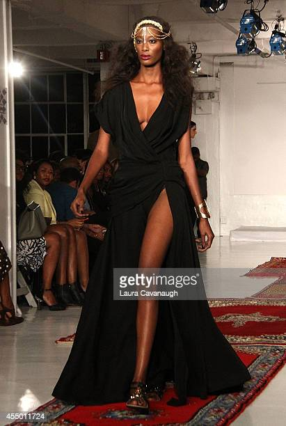 Model walks the runway at the Edwing D'Angelo show during MercedesBenz Fashion Week Spring 2015 at The Designer's Loft on September 8 2014 in New...