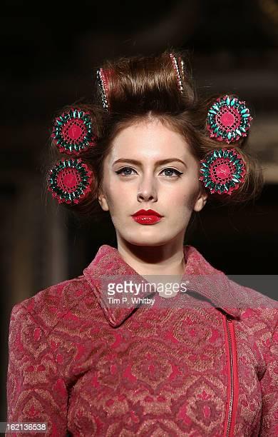 A model walks the runway at the Ekaterina Kukhareva show during London Fashion Week Fall/Winter 2013/14 at Freemasons Hall on February 19 2013 in...
