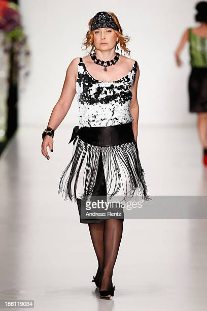 A model walks the runway at the ELENA SOUPROUN By Elena Suprun show during MercedesBenz Fashion Week Russia S/S 2014 on October 28 2013 in Moscow...