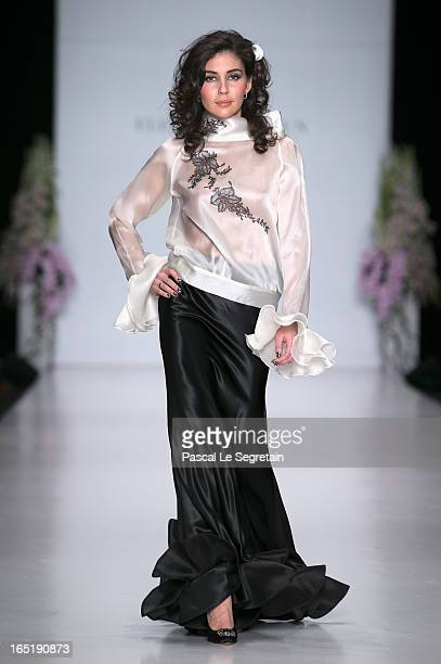 A model walks the runway at the Elena Souproun show during MercedesBenz Fashion Week Russia Fall/Winter 2013/2014 at Manege on April 1 2013 in Moscow...