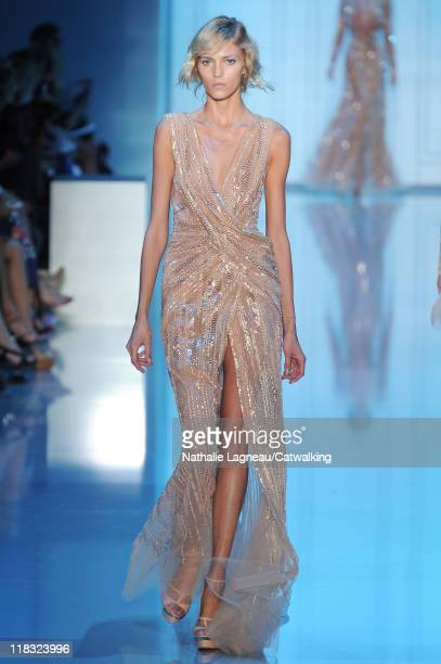 A model walks the runway at the Elie Saab Haute Couture Autumn Winter 2011 fashion show during Paris Autumn Winter 2011 Haute Couture Week on July 6...