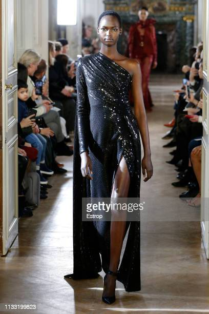 Model walks the runway at the Elie Saab show at Paris Fashion Week Autumn/Winter 2019/20 on March 2, 2019 in Paris, France.