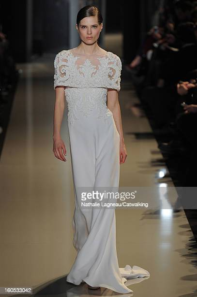 A model walks the runway at the Elie Saab Spring Summer 2013 fashion show during Paris Haute Couture Fashion Week on January 23 2013 in Paris France
