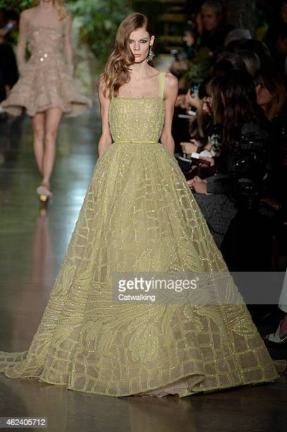 A model walks the runway at the Elie Saab Spring Summer 2015 fashion show during Paris Haute Couture Fashion Week on January 28 2015 in Paris France