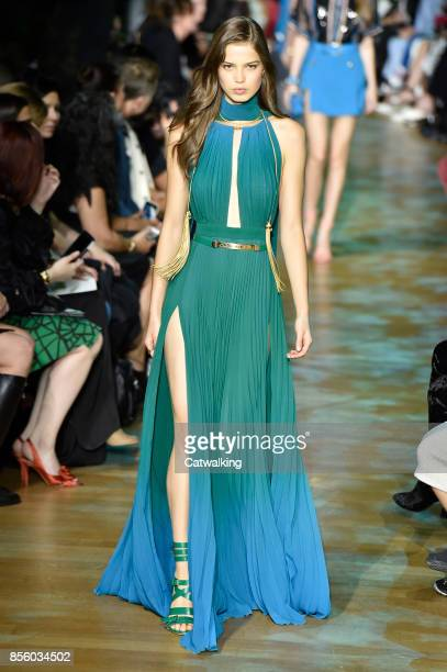 A model walks the runway at the Elie Saab Spring Summer 2018 fashion show during Paris Fashion Week on September 30 2017 in Paris France