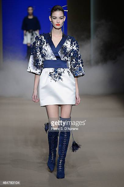 A model walks the runway at the Elisabetta Franchi show during the Milan Fashion Week Autumn/Winter 2015 on February 28 2015 in Milan Italy