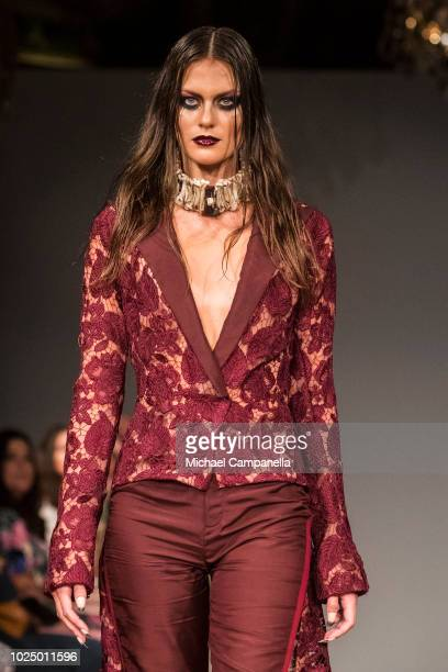 A model walks the runway at the Emelie Janrell show during Stockholm Runway SS19 at Grand Hotel on August 29 2018 in Stockholm Sweden