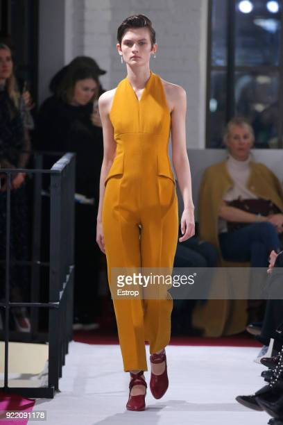 A model walks the runway at the Emilia Wickstead show during London Fashion Week February 2018 at Great Portland Street on February 19 2018 in London...
