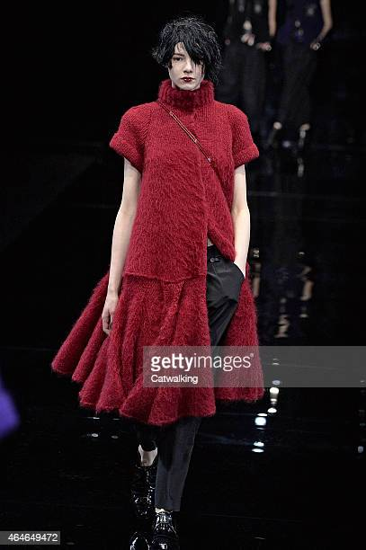 Model walks the runway at the Emporio Armani Autumn Winter 2015 fashion show during Milan Fashion Week on February 27, 2015 in Milan, Italy.