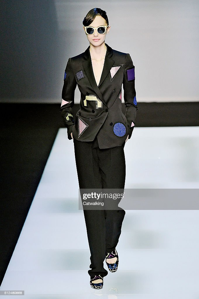 0a12dce6 A model walks the runway at the Emporio Armani Autumn Winter 2016 ...