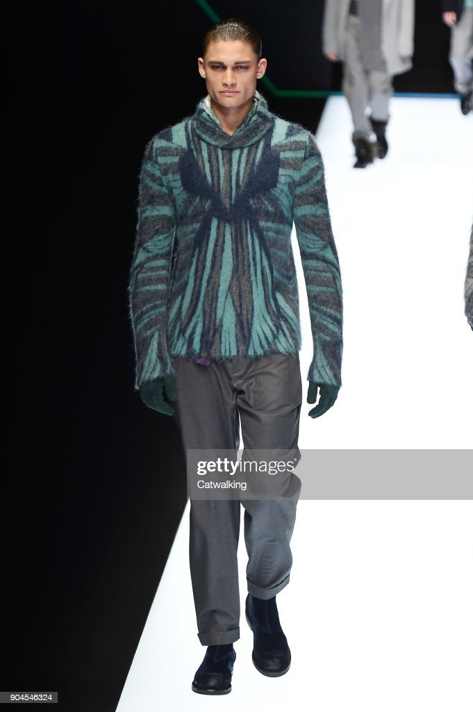 A model walks the runway at the Emporio Armani Autumn Winter 2018 fashion show during Milan Menswear Fashion Week on January 13, 2018 in Milan, Italy.