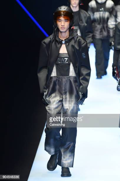 A model walks the runway at the Emporio Armani Autumn Winter 2018 fashion show during Milan Menswear Fashion Week on January 13 2018 in Milan Italy