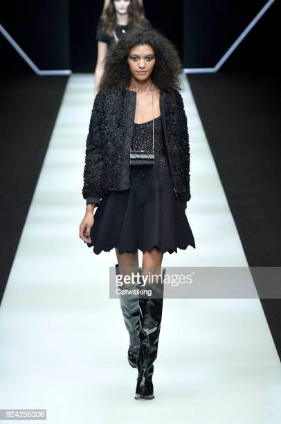A model walks the runway at the Emporio Armani Autumn Winter 2018 fashion show during Milan Fashion Week on February 25 2018 in Milan Italy