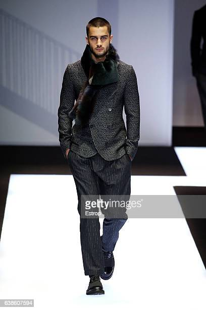A model walks the runway at the Emporio Armani designed by Giorgio Armani show during Milan Men's Fashion Week Fall/Winter 2017/18 on January 14 2017...