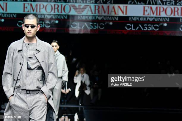 A model walks the runway at the Emporio Armani Fall/Winter 20202021 fashion show during Milan Men's Fashion Week on January 11 2020 in Milan Italy