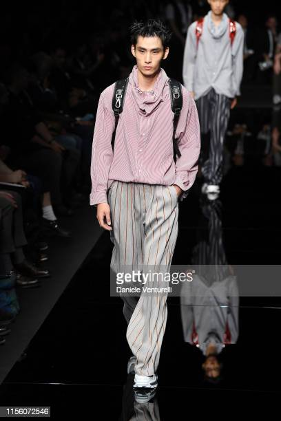 A model walks the runway at the Emporio Armani fashion show during the Milan Men's Fashion Week Spring/Summer 2020 on June 15 2019 in Milan Italy
