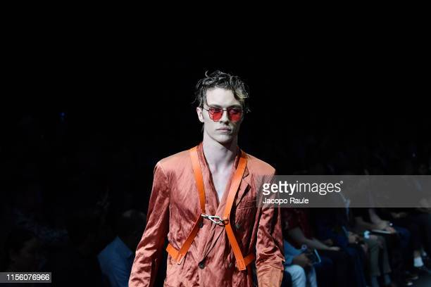 Model walks the runway at the Emporio Armani fashion show during the Milan Men's Fashion Week Spring/Summer 2020 on June 15, 2019 in Milan, Italy.
