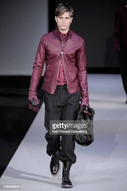 A model walks the runway at the Emporio Armani menswear fashion show during Milan Fashion Menswear Week on January 16 2011 in Milan Italy