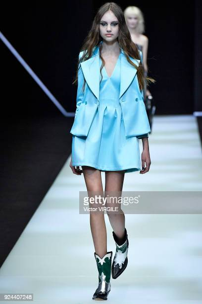 A model walks the runway at the Emporio Armani Ready to Wear Fall/Winter 20182019 fashion show during Milan Fashion Week Fall/Winter 2018/19 on...