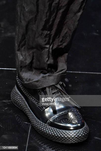 A model walks the runway at the Emporio Armani Ready to Wear fashion show during Milan Fashion Week Spring/Summer 2019 on September 20 2018 in Milan...