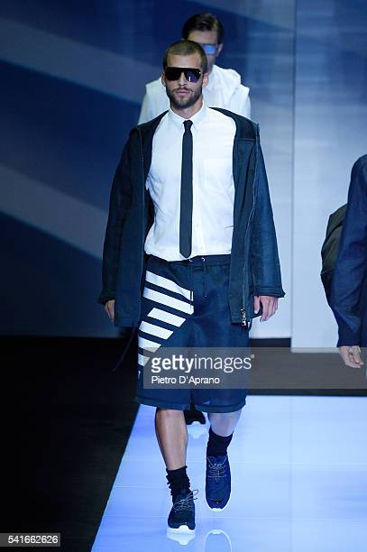 A model walks the runway at the Emporio Armani show during Milan Men's Fashion Week Spring/Summer 2017 on June 20 2016 in Milan Italy