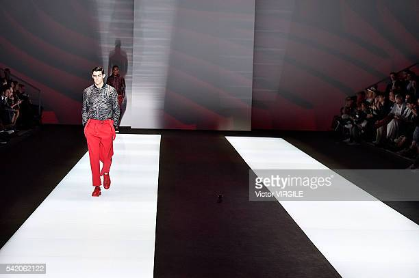 Model walks the runway at the Emporio Armani show during Milan Men's Fashion Week Spring/Summer 2017 on June 20, 2016 in Milan, Italy.