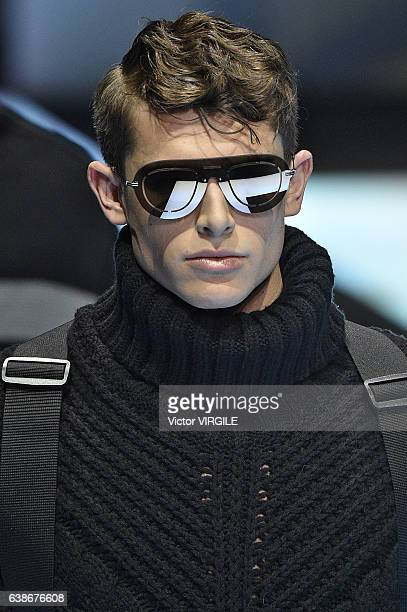 A model walks the runway at the Emporio Armani show during Milan Men's Fashion Week Fall/Winter 2017/18 on January 14 2017 in Milan Italy