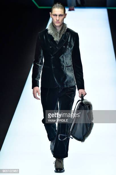 A model walks the runway at the Emporio Armani show during Milan Men's Fashion Week Fall/Winter 2018/19 on January 13 2018 in Milan Italy