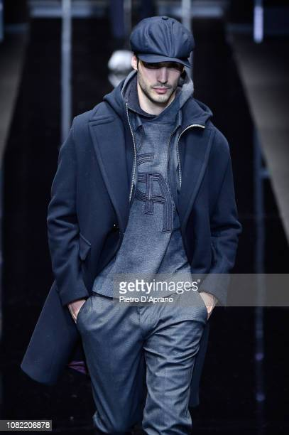 A model walks the runway at the Emporio Armani show during Milan Menswear Fashion Week Autumn/Winter 2019/20 on January 14 2019 in Milan Italy
