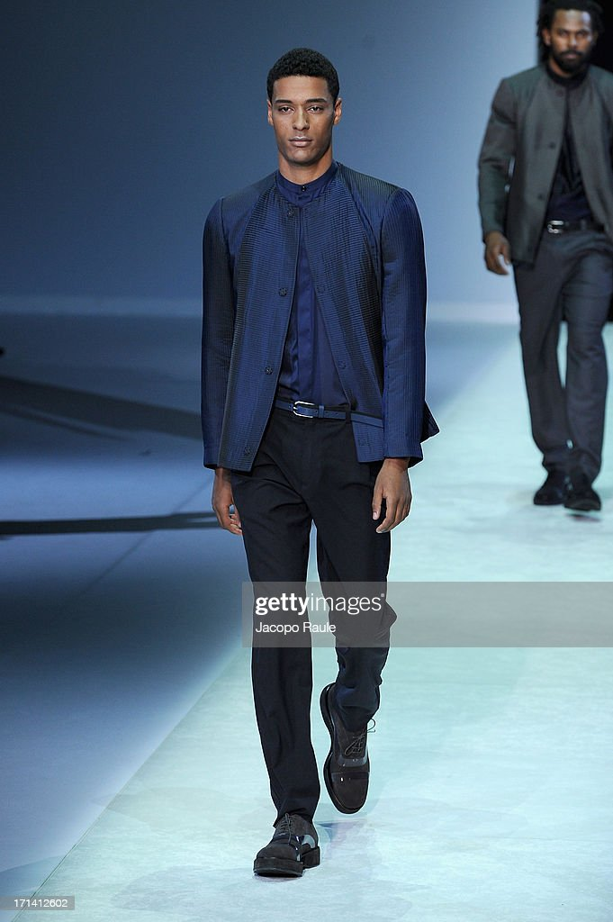 A model walks the runway at the Emporio Armani show during Milan Menswear Fashion Week Spring Summer 2014 show on June 24, 2013 in Milan, Italy.