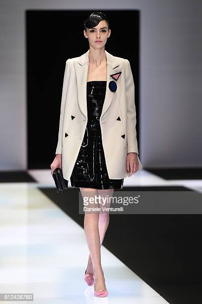 A model walks the runway at the Emporio Armani show during Milan Fashion Week Fall/Winter 2016/17 on February 26 2016 in Milan Italy