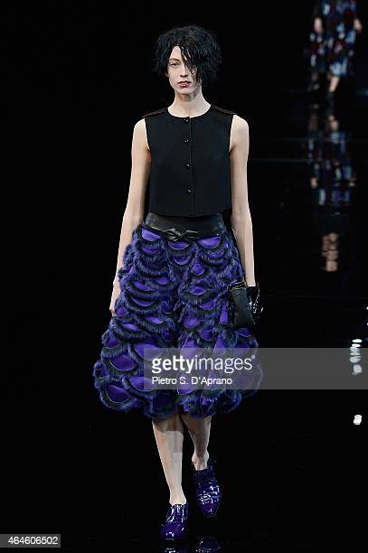 A model walks the runway at the Emporio Armani show during the Milan Fashion Week Autumn/Winter 2015 on February 27 2015 in Milan Italy