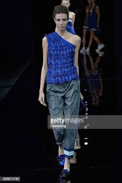 Model walks the runway at the Emporio Armani Spring Summer 2015 fashion show during Milan Fashion Week on September 18, 2014 in Milan, Italy.