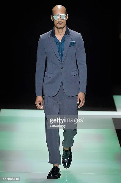 A model walks the runway at the Emporio Armani Spring Summer 2016 fashion show during Milan Menswear Fashion Week on June 20 2015 in Milan Italy