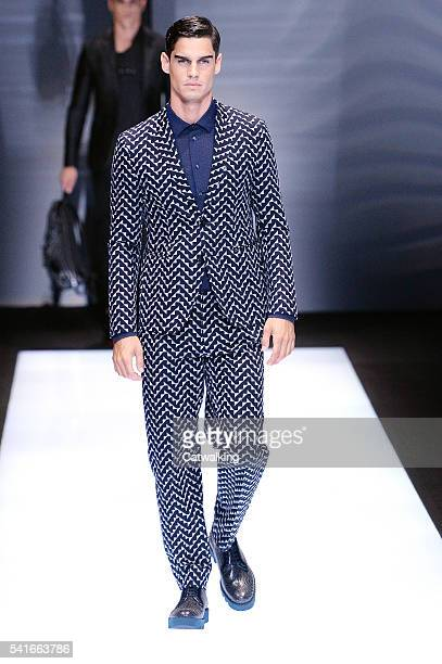Model walks the runway at the Emporio Armani Spring Summer 2017 fashion show during Milan Menswear Fashion Week on June 20, 2016 in Milan, Italy.