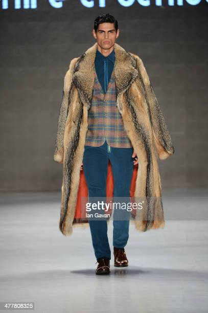 A model walks the runway at the Emre Erdemoglu show during MBFWI presented by American Express Fall/Winter 2014 on March 11 2014 in Istanbul Turkey