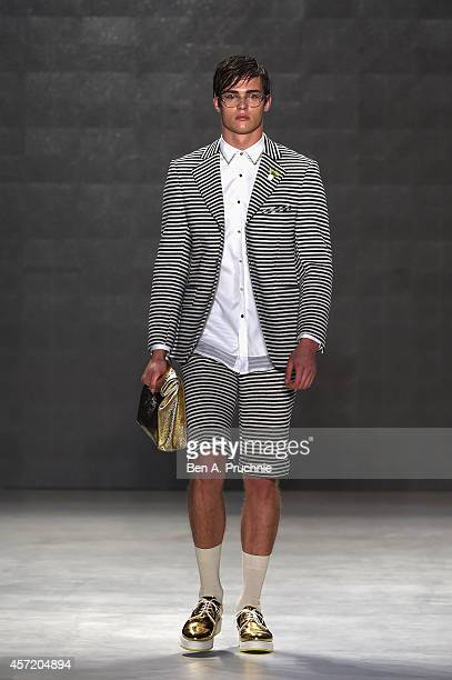 A model walks the runway at the Emre Erdemoglu show during Mercedes Benz Fashion Week Istanbul SS15 at Antrepo 3 on October 14 2014 in Istanbul Turkey