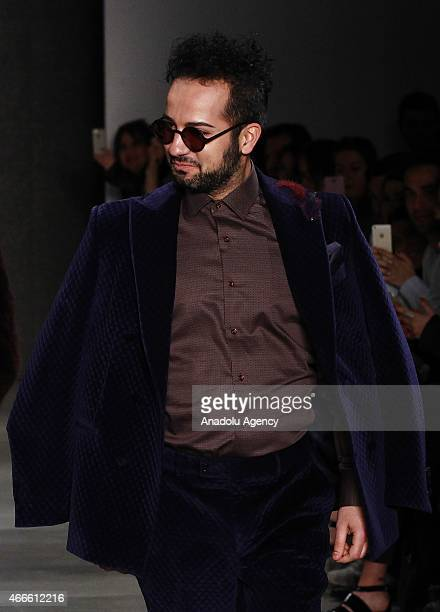 A model walks the runway at the Emre Erdemoglu show during Mercedes Benz Fashion Week Istanbul FW15 on March 17 2015 in Istanbul Turkey