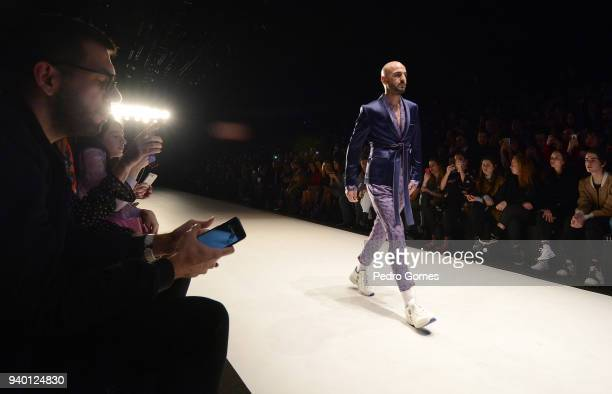 A model walks the runway at the Emre Erdemoglu show during Mercedes Benz Fashion Week Istanbul at Zorlu Performance Hall on March 30 2018 in Istanbul...